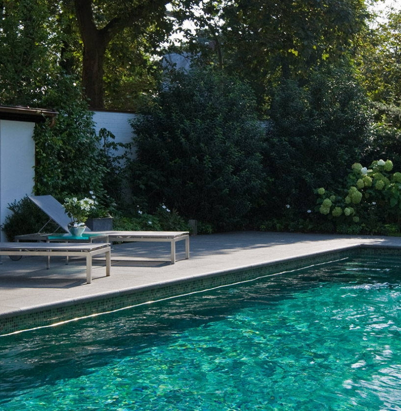 An emerald green swimming pool dream in a garden oasis with energy ...